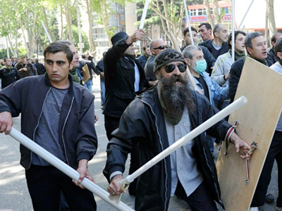 Georgian opposition activists clash with sticks as they protest during a rally against President Saakashvili in Tbilisi on May 22, 2011 (AFP Photo / Vano Shlamov)