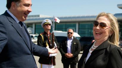 Georgian President Mikheil Saakashvili (L) speaks with U.S. Secretary of State Hillary Clinton at Batumi International Airport, before her departure for Baku in Azerbaijan, June 6, 2012 (Reuters/Saul Loeb/Pool)