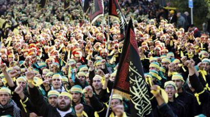 Supporters of the Shiite Muslim Hezbollah movement take part in a parade in the city of Nabatiyeh in southern Lebanon