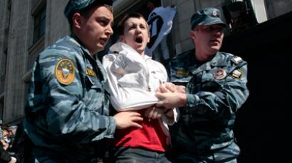 Policemen detain an activist of the National Bolshevik Party for taking part in a rally protesting a bill, initiated by the Russian State Duma, to authorize bigger fines for violations during rallies in central Moscow, June 5, 2012 (Reuters/Sergei Karpukhin)