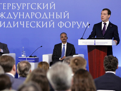 Russian Prime Minister Dmitry Medvedev, right, addresses the 2nd St Petersburg International Legal Forum, 17 May 2012. (RIA Novosti / Dmitry Astakhov)