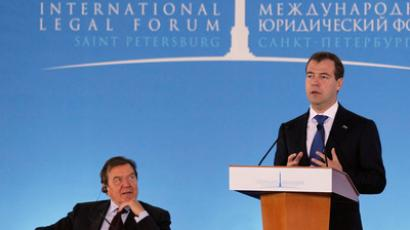 President Dmiry Medvedev (right) speaking at the plenary session of the St. Petersburg International Legal Forum. Moderator of the session is former German Chancellor Gerhard Schroeder (left). May 20, 2011. (RIA Novosti / POOL)