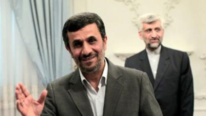 Iranian President Mahmoud Ahmadinejad waves to photographers as he waits for the arrival of Russia's National Security Council secretary Nikolai Patrushev for a meeting in Tehran on August 16, 2011 (AFP Photo / Behrouz Mehri)
