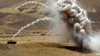 Smoke rises from artillery rounds fired during a military exercise for the Israeli army in the Shivta Field Artillery School, south of Beer Sheva, on May 24, 2012. (AFP Photo/Jack Guez)