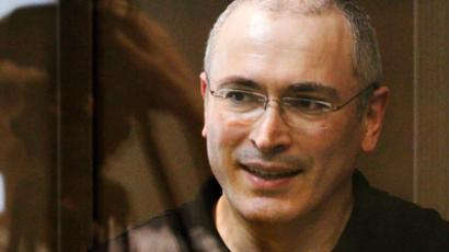 Jailed Russian ex-tycoon Mikhail Khodorkovsky stands in the defendant's box during a court session in Moscow May 24, 2011 (Reuters/Denis Sinyakov)
