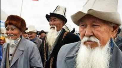 Kyrgyz opposition supporters attend a rally in the village of Baityk demanding the resignation of President Kurmanbek Bakiyev (AFP/Vyacheslav Oseledko).