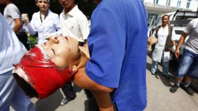 Person injured during unrest in the city of Osh, Kyrgyzstan. June 26, 2010 (RIA Novosti / Andrey Stenin)