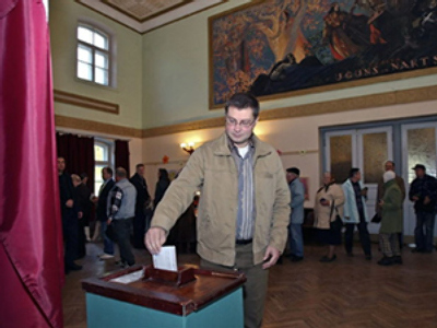 Prime Minister of Latvia Valdis Dombrovskis casts his ballot a polling station in Ligatne on October 2, 2010, during Latvian Parliament elections (AFP Photo / Aovars Liepins)