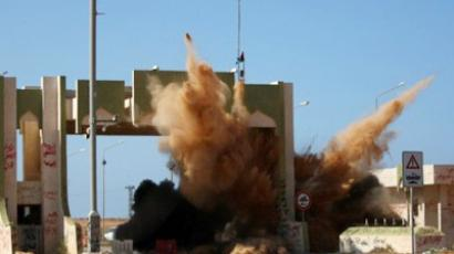 Transitional Council (NTC) fighters destroy Sirte's eastern gate which they say symbolised the former regime's oppression on October 5, 2011 (AFP Photo / Ahmad Al-Rubaye)