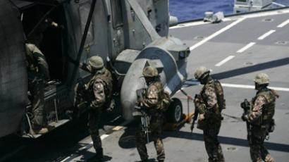 "Soldiers embark aboard an helicopter ready to take off from the Italian aircraft carrier ""Giuseppe Garibaldi"" during ""Unified Protectors"" NATO operation on June 15, 2011 in the Mediterranean sea (AFP Photo / Marcello Paternostro)"