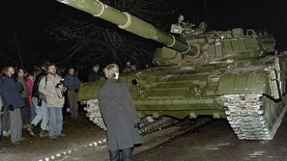 Lithuania, Vilnius: A Lithuanian demonstrator stands in front of a Soviet Red Army tank during the assault on the Lithuanian Radio and Television station on January 13, 1991 in Vilnius.
