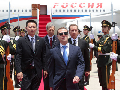 April 13, 2011. Russian President Dmitry Medvedev, walking past the guards of honor at his welcome ceremony, Sanya Phoenix International Airport, Hainan Island. (RIA Novosti / Michael Klimentyev)