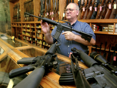 Gun dealer displays several United States-made assault-style rifles inside his gun shop. (Reuters / Jeff Mitchell US)