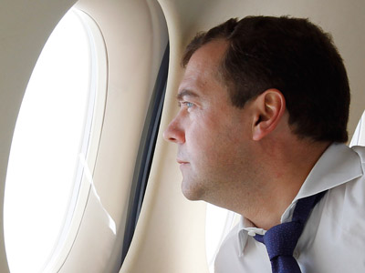 Prime Minister Dmitry Medvedev seen on board the plane while flying to the Kuril Islands, July 3, 2012. (RIA Novosti/Dmitry Astakhov)