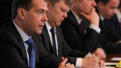 President Dmitry Medvedev, left, at a meeting with representatives of registered political parties at the Gorki residence. (RIA Novosti / Ekaterina Shutkina)