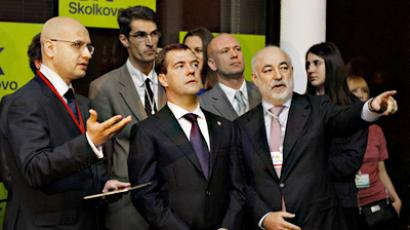President Dmitry Medvedev (center) visiting an exhibition of presentations of Skolkovo projects at a new Moscow IT-Center Digital October (RIA Novosti / Dmitry Astakhov)