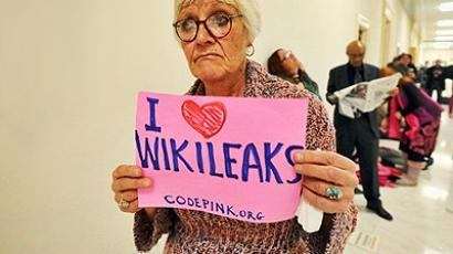 Washington: WikiLeaks supporters display placards and banners. (AFP Photo/ Jewel Samad)