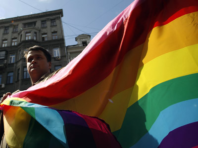 A gay rights activist takes part in a gay pride parade near the headquarters of Moscow city Duma in central Moscow May 27, 2012. (Reuters/Maxim Shemetov)