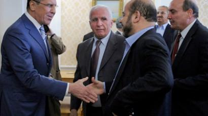 Russian Foreign Minister Sergei Lavrov (L) welcomes Fatah member Azzam al-Ahmed (2-L) Mussa Abu Marzuk of Hamas (3-L) , and Maher al-Taher (R) of the Popular Front for the Liberation of Palestinetheir meeting in Moscow on May 23, 2011 (AFP Photo / Alexander Nemenov)