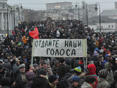 Participants of the For Fair Elections rally on Bolotnaya Square in Moscow.(RIA Novosti / Artem Zhitenev)