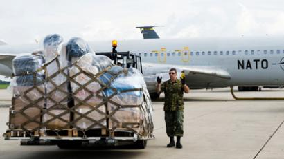 A Trainer Cargo Aircraft of the NATO Airborne Early Warning and Control Force (AWACS) ready to transport relief goods (Photo from www.nato.int)