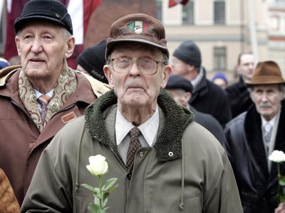 Waffen SS legionnaires and their supporters marching in Riga. (RIA Novosti / Oksana Dzhadan)