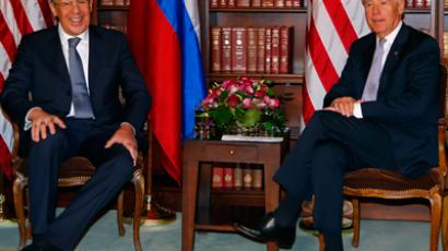 Sergei Lavrov (L) and Joe Biden (Reuters / Michael Dalder)