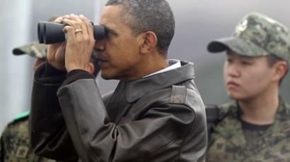U.S. President Barack Obama looks through binoculars to see North Korea from Observation Post Ouellette during a visit to the truce village of Panmunjom in the demilitarised zone (DMZ) separating the two Koreas, north of Seoul March 25, 2012.  (Reuters/Yuriko Nakao)