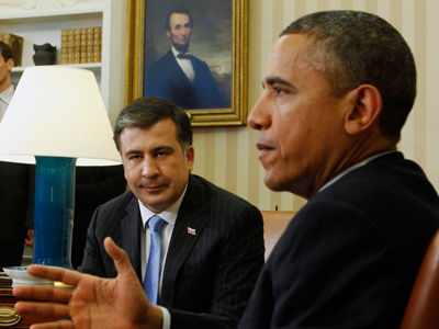 Georgia's President Mikhail Saakashvili (back) listens as US President Barack Obama talks to the press in the Oval Office of the White House in Washington January 30, 2012 (Reuters / Larry Downing)