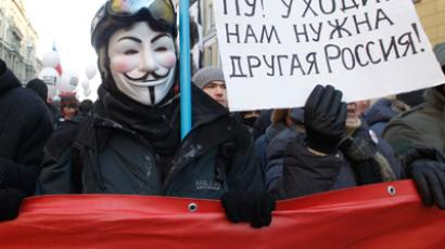 A protester wearing a Guy Fawkes mask marches with other during a demonstration for fair elections in St. Petersburg(Reuters / Alexander Demianchuk)