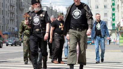 Members of the Union of Orthodox Christian Gonfalon Bearers, religious and political organization, seen walking on Moscow's Tverskaya Street (RIA Novosti/Konstantin Rodikov)