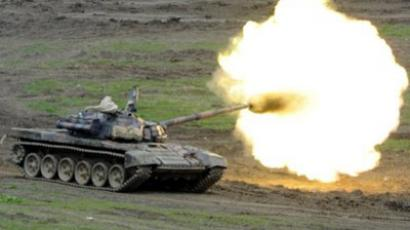 A Georgian army tank fires during a training exercise at the Vaziani military base (AFP Photo/ Pool / Irakli Gedenidze)