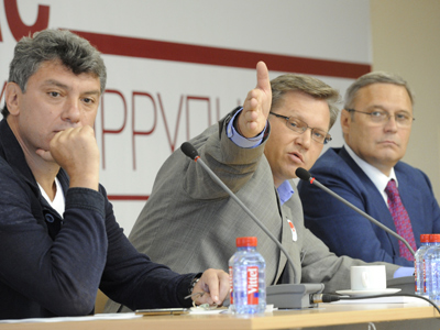 Co-Chairman of the People's Freedom Party Boris Nemtsov (L), leader of the Republican Party of Russia Vladimir Ryzhkov (C) and co-chair of the People's Freedom Party Mikhail Kasyanov (RIA Novosti / Alexey Kudenko)