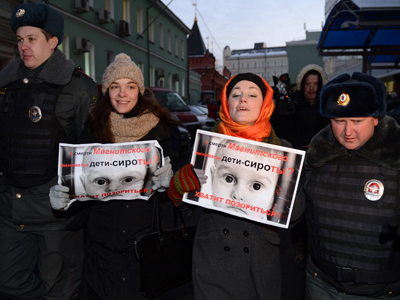 Moscow police break up pickets against US adoptions ban