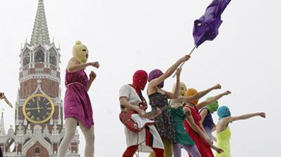 Members of the Russian radical feminist group 'Pussy Riot' perform in Red Square in Moscow January 20, 2012. (Reuters / Denis Sinyakov)