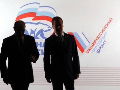 PM Vladimir Putin has put forth Medvedev to lead United Russia elections list (AFP Photo / Natalia Kolesnikova)