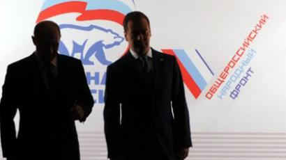 PM Vladimir Putin has put forth Medvedev to lead United Russia elections list (AFP Photo / Natalia Kolesnikova)