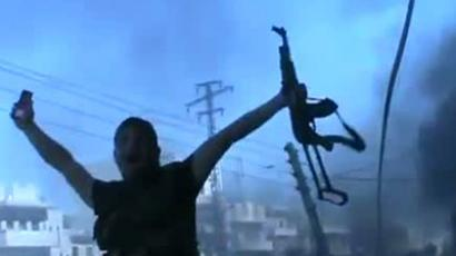 An image grab taken from a video uploaded on YouTube on July 23, 2012 shows Syrian rebel fighters battling government troops in the northern city of Aleppo. (AFP Photo/YouTube)