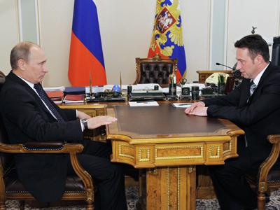 Vladimir Putin (L) and Igor Kholmanskikh (RIA Novosti / Yana Lapikova)