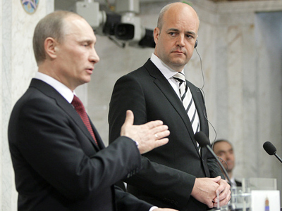 Prime Minister Vladimir Putin (L) and his Swedish counterpart Fredrik Reinfeldt (RIA Novosti / Alexey Druzhinin)