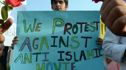 "A Pakistani student holds a placard during a protest against the controversial film ""Innocence of Muslims"" in Islamabad on September 25, 2012. (AFP Photo/Farooq Naeem)"