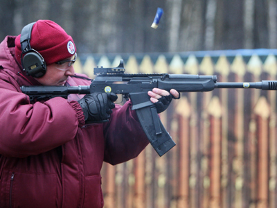 Dmitry Rogozin takes part in the shooting pistol, rifle and shotgun open competition (RIA Novosti / Sergey Mamontov)