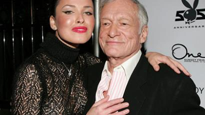 Hugh Hefner, founder of Playboy magazine, poses with Ukrainian playmate Dasha Astafieva during journal's 55th anniversary celebrations.