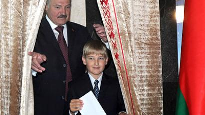 Belarus's President Alexander Lukashenko (L) stands with his son Nikolay prior to cast his ballot on September 23, 2012 in Minsk. (AFP Photo / Viktor Drachev)