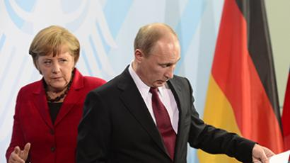 German Chancellor Angela Merkel (L) and Russian President Vladimir Putin. (AFP Photo / John Macdougall)