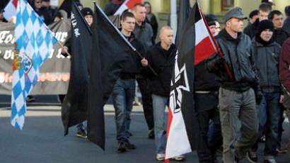 Participants of a neo-Nazi demonstration march in Riga, Latvia (AFP Photo / David Ebener)