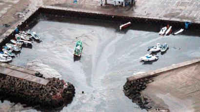 This aerial shot shows boats being carried away at a flooded marina in Hitachinaka city in Ibaraki prefecture on March 11, 2011 after a tsunami hit following an earthquake