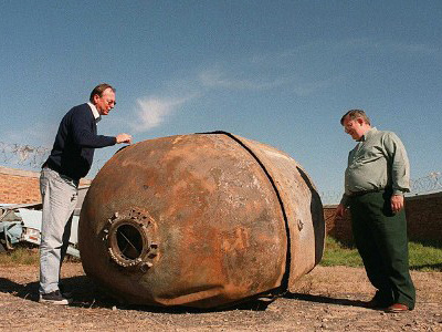 Researchers examine piece of space junk that came down in Cape Town on April 27, 2000 (AFP Photo)