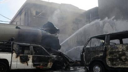 Burnt vehicles at the scene of a bomb explosion in central Damascus near the hotel used by the UN observer mission in Syria on August 15, 2012. (AFP Photo)