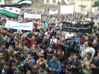 Demonstrators protest against Syria's President Bashar al-Assad in Hula near Homs January 6, 2012 (Reuters / Handout)